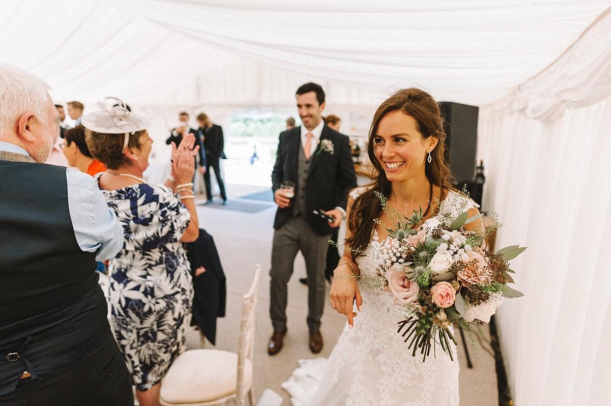 bride entering wedding breakfast room