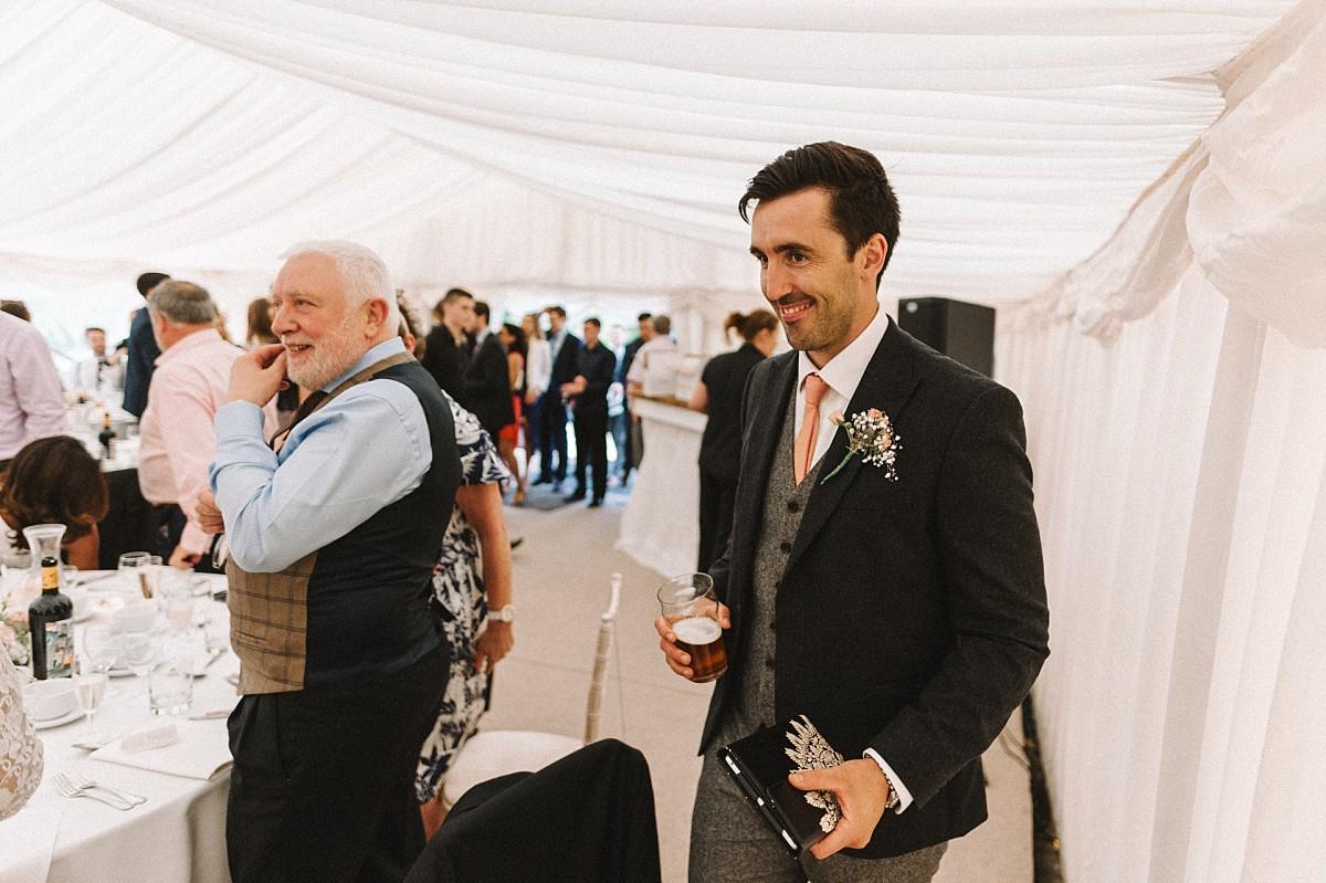 groom entering wedding breakfast room
