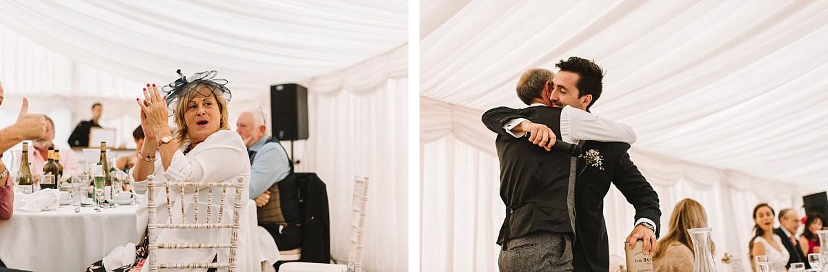 groom hugging dad on wedding day