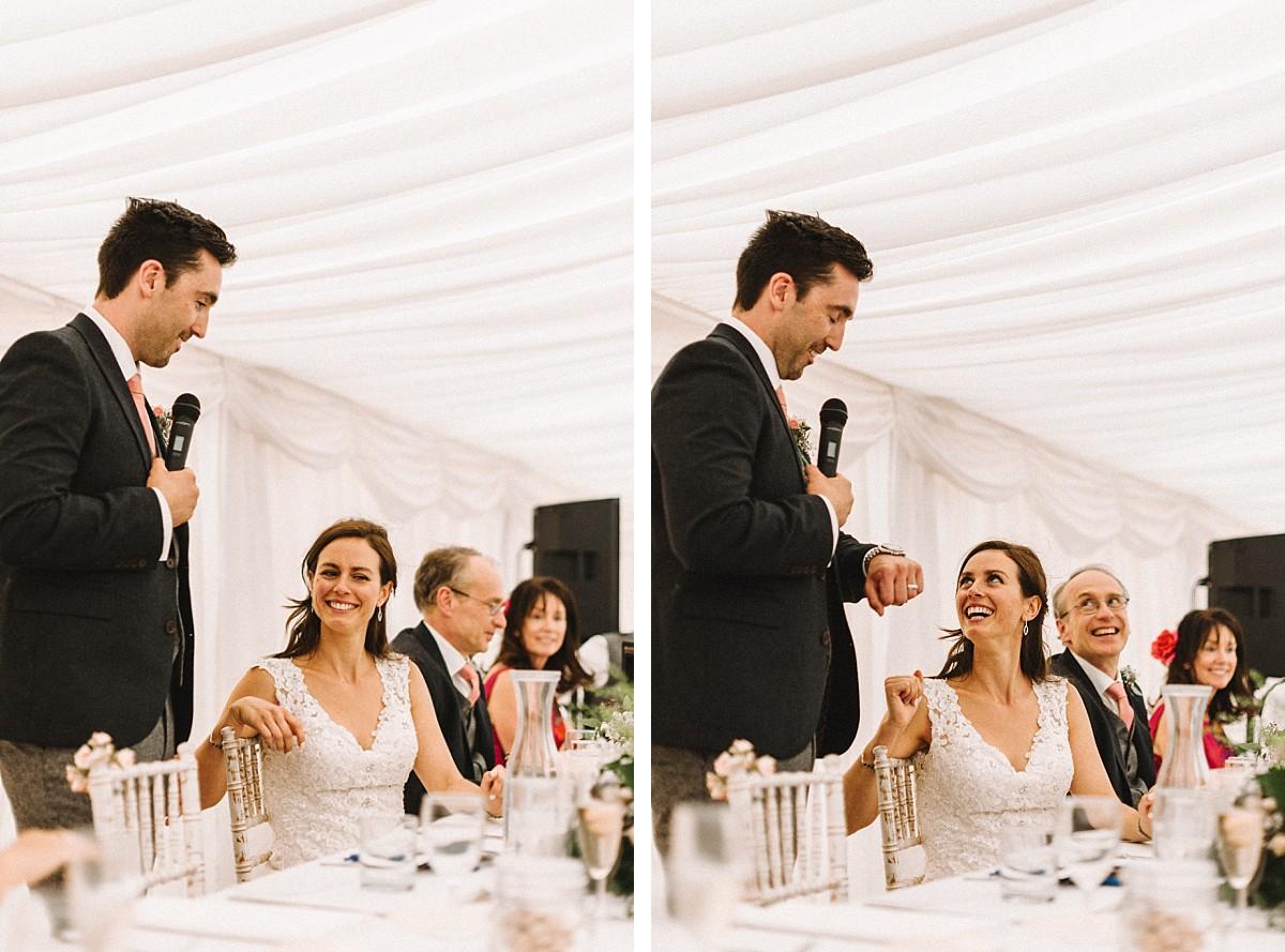 bride laughing at groom wedding speech