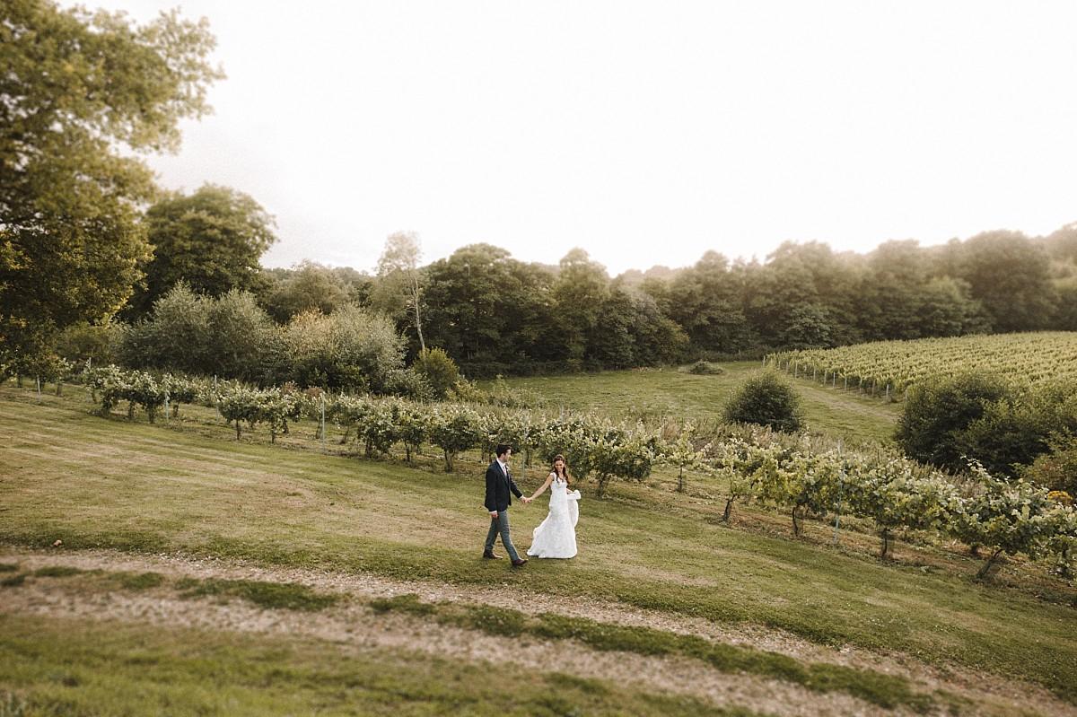 couple walking in vineyard