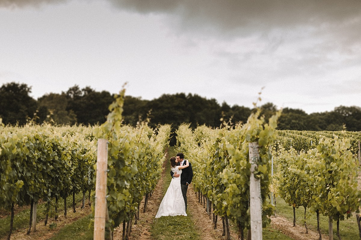 colour photograph of couple in vineyard