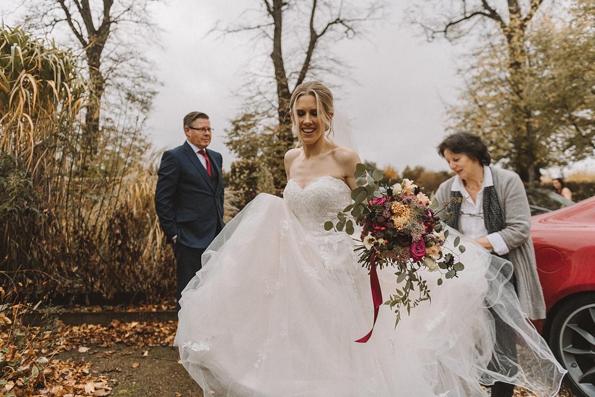 Bridearriving at Barn wedding in Surrey