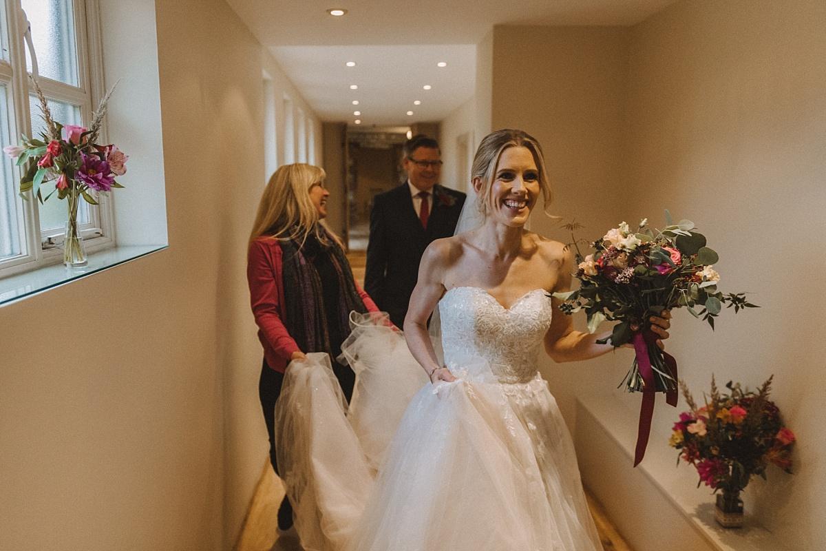 Bride walking through Barn wedding venue in Surrey
