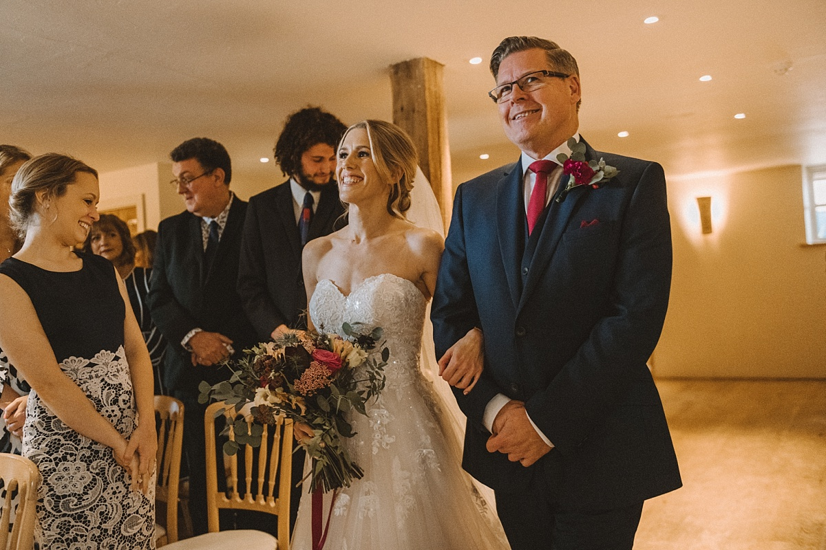 Bride being walked in by father