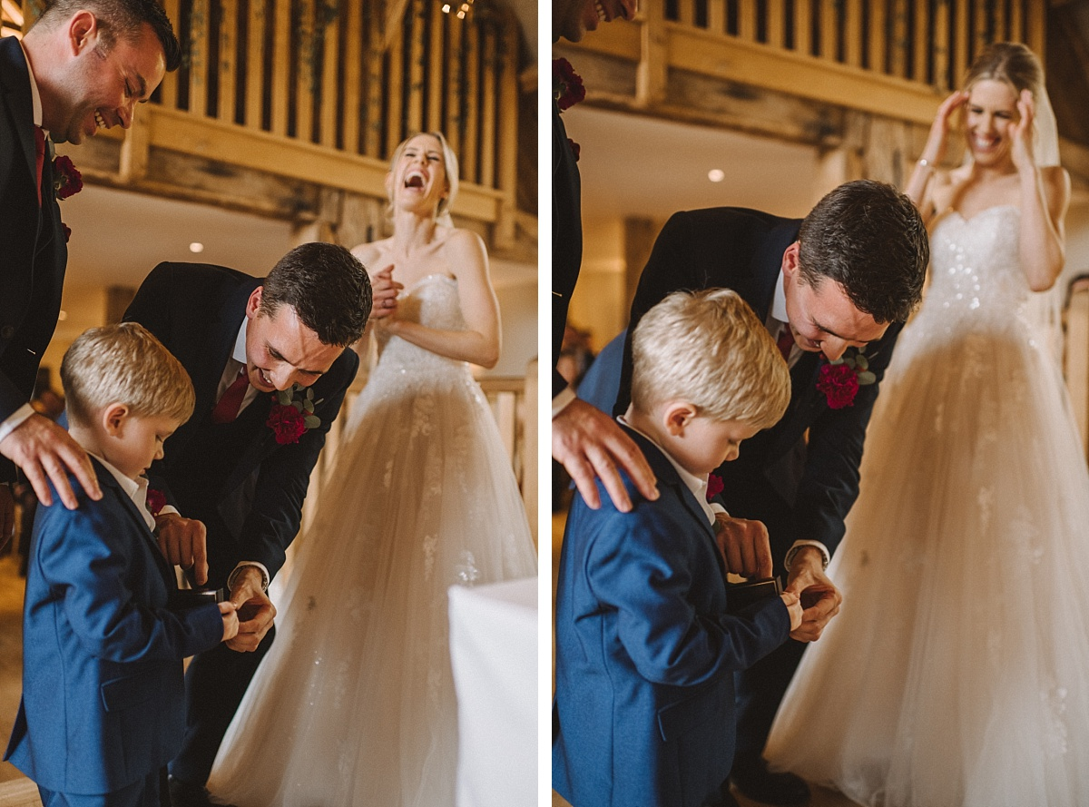 Young son carries wedding ring to mum & dad