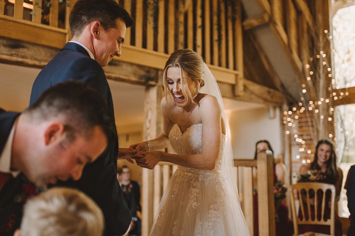 Bride laughing at Bury Court Barn wedding