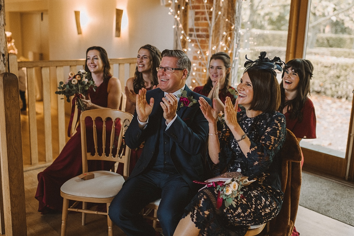 Family of bride watching daughter get married