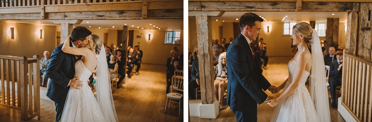 Photography of first kiss at Bury Court Barn