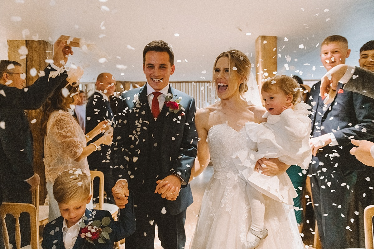 couple just married at barn wedding in Surrey