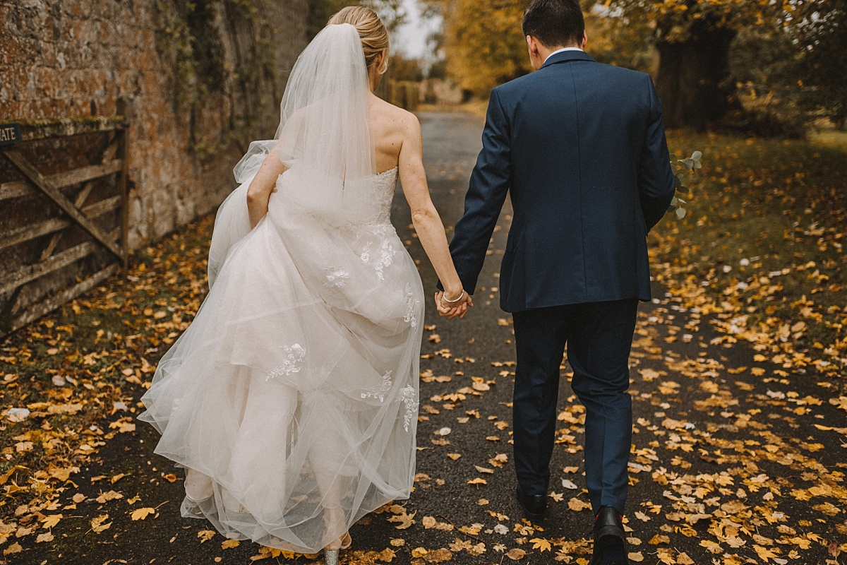 Newlywed couple holding hands