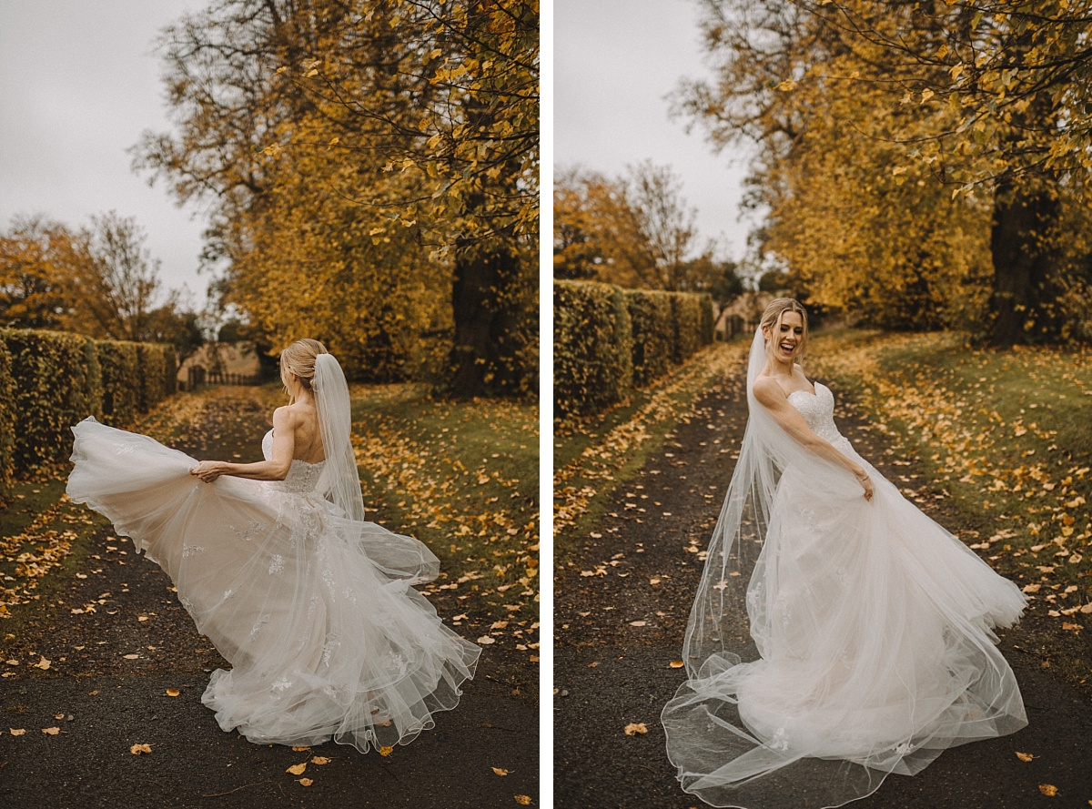 Bride waving around dress on Autumn leaves