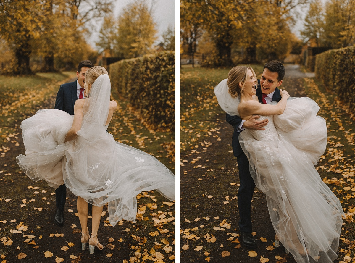 groom holding bride with Autumn leaves behind