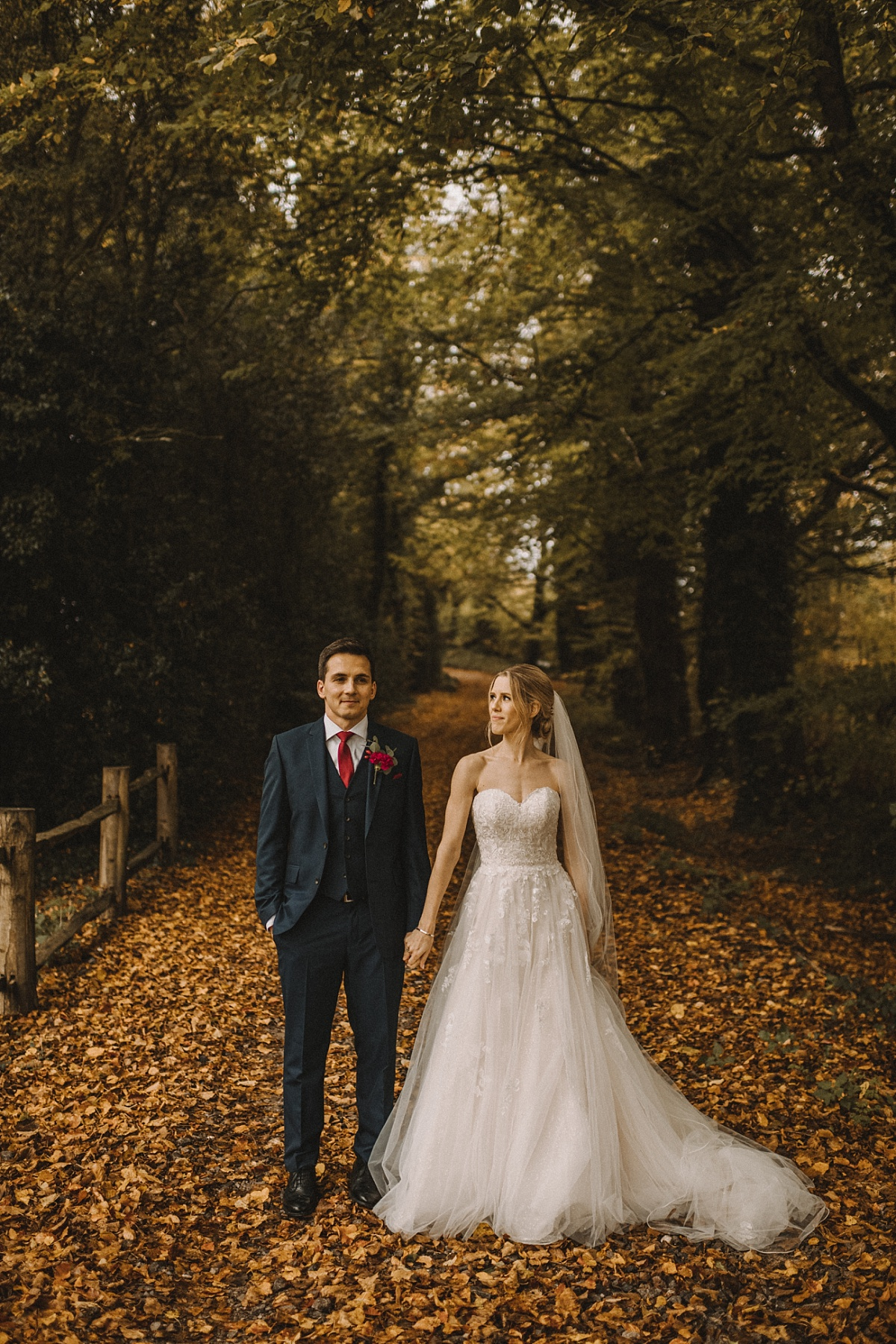 Photo of Bride looking at groom on lane at Bury Court Barn