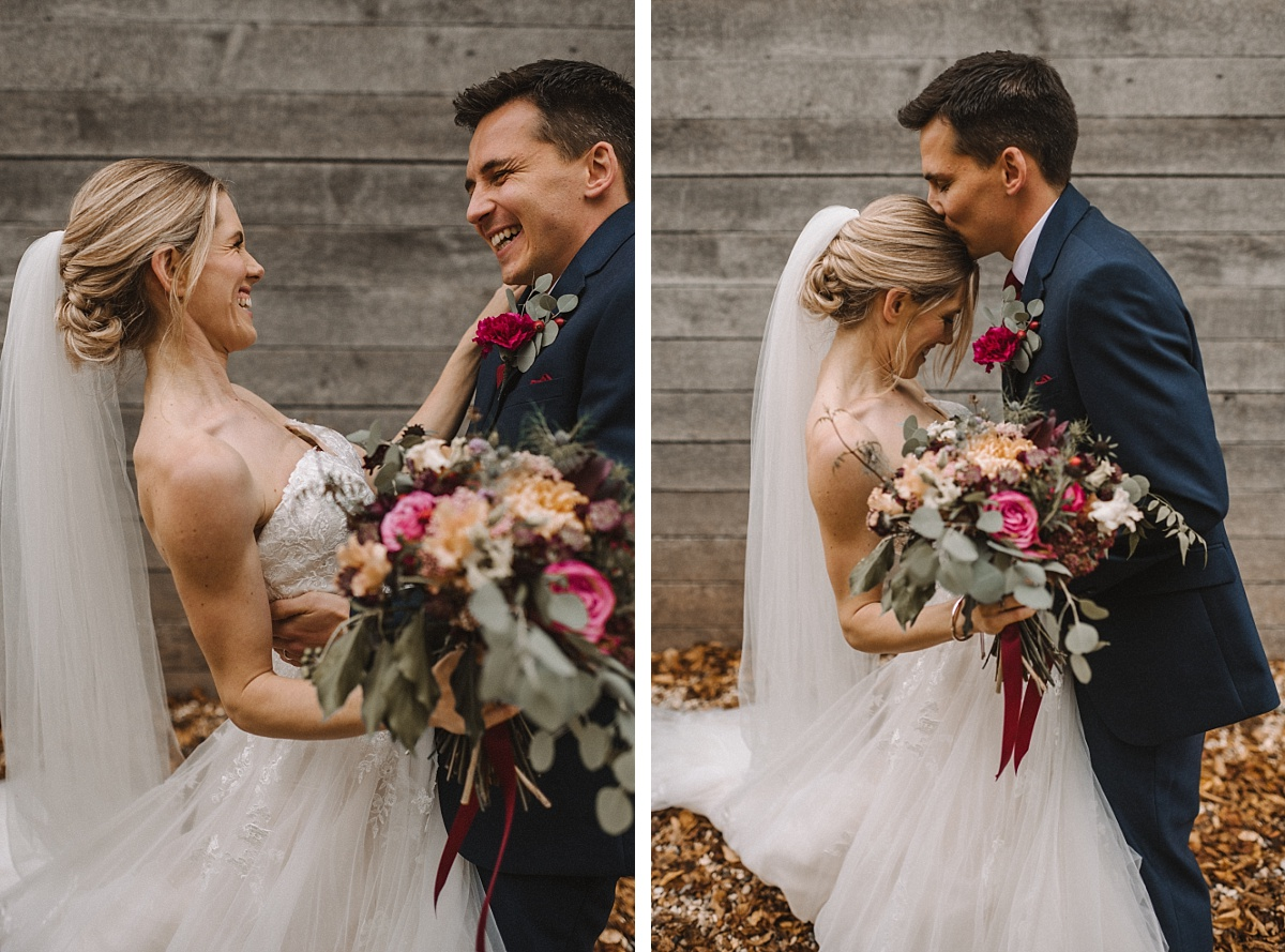 Couple laughing and kissing in front of Barn at Bury Court Barn