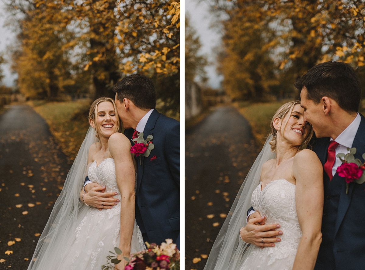 Married couple and colourful leaves at Bury Court Barn