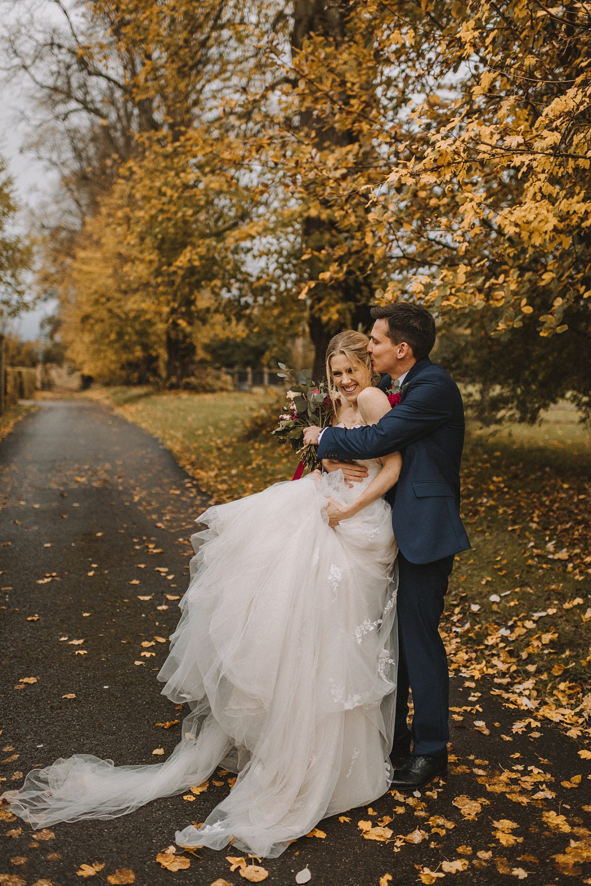 Colour photo of couple during Autumn wedding Bury Court Barn