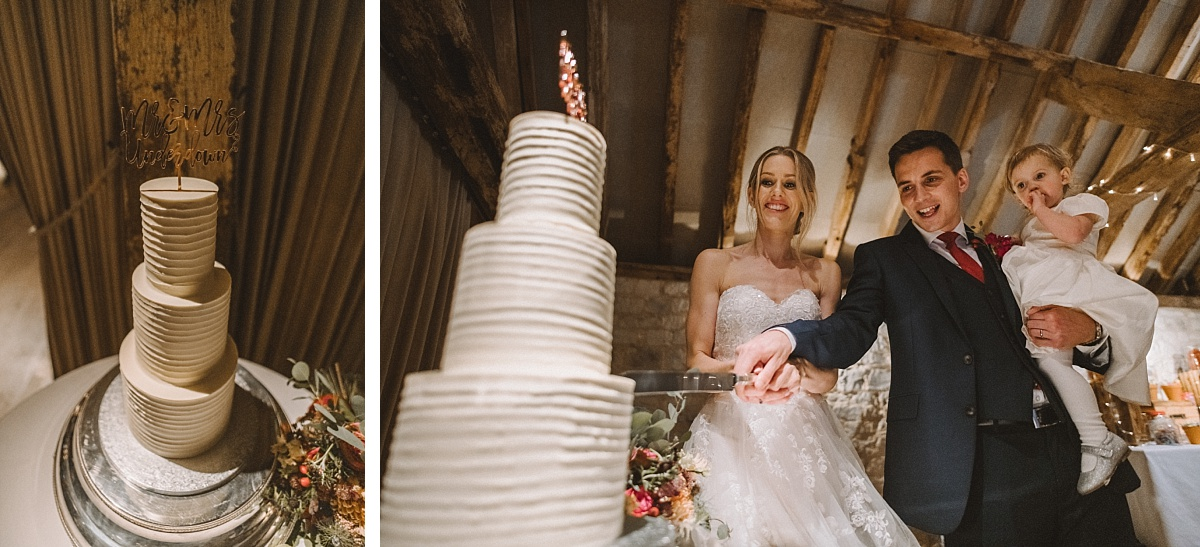 Couple cutting cake at Surrey wedding at Bury Court Barn