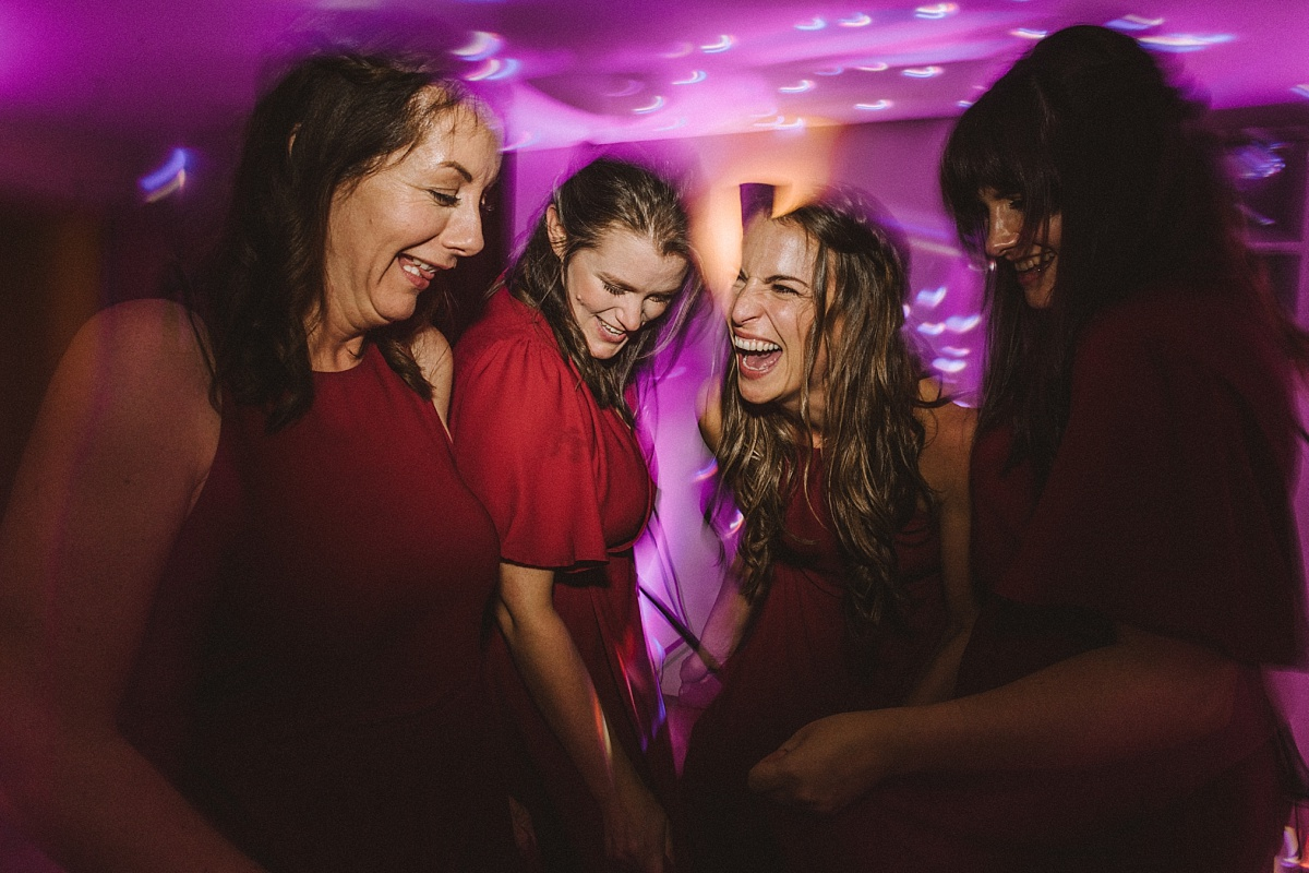 Bridesmaids dancing at reception at Bury Court Barn