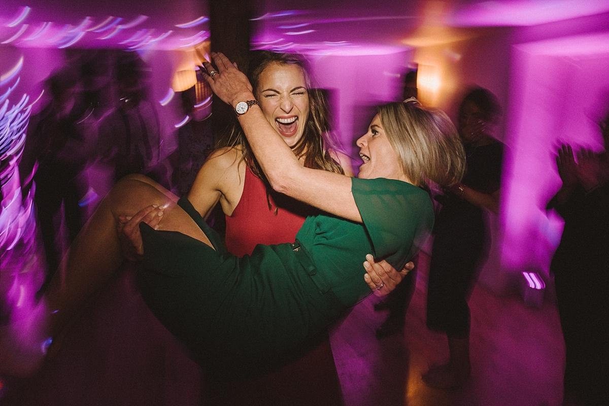 Bridesmaids dancing at wedding at Bury Court Barn