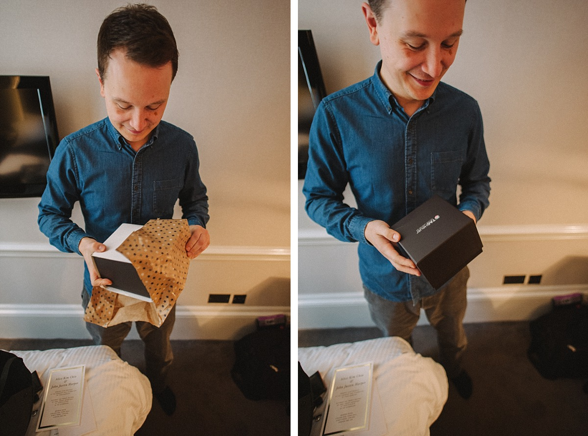 Groom opening wedding present from his Wife to be