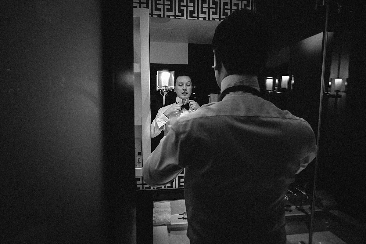 Black & White photo of Groom getting ready, by Matt Lee, Chelsea Wedding Photographer
