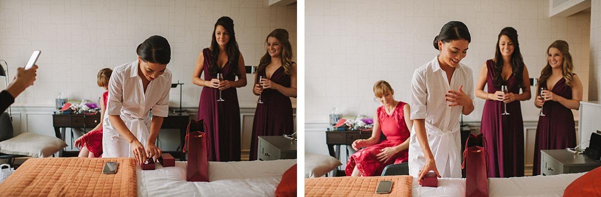 Bride opening present on morning of her wedding by Chelsea Wedding Photographer, Matt Lee