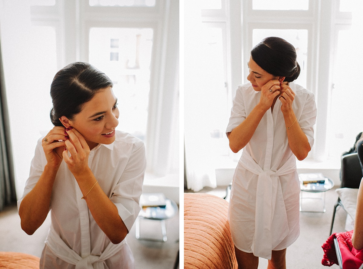 Bride putting in wedding ear rings by Chelsea Wedding Photographer
