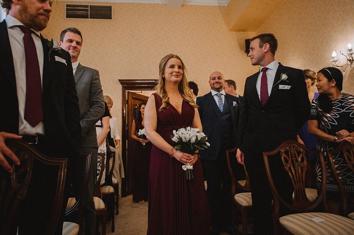 Bridesmaid walking down aisle taken by Matt Lee, Chelsea Wedding Photographer