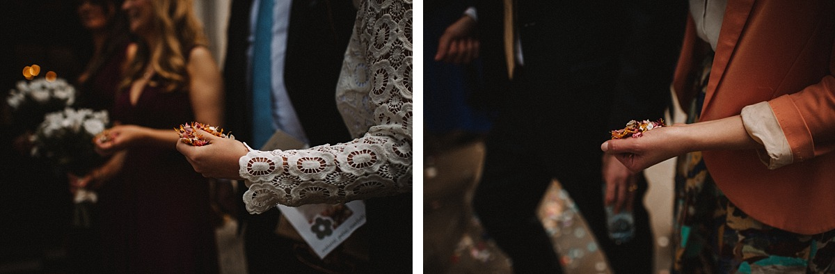 Photo of guests hands holding confetti
