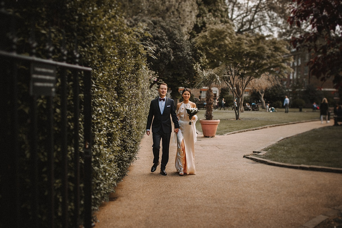 Married couple walking through London Park