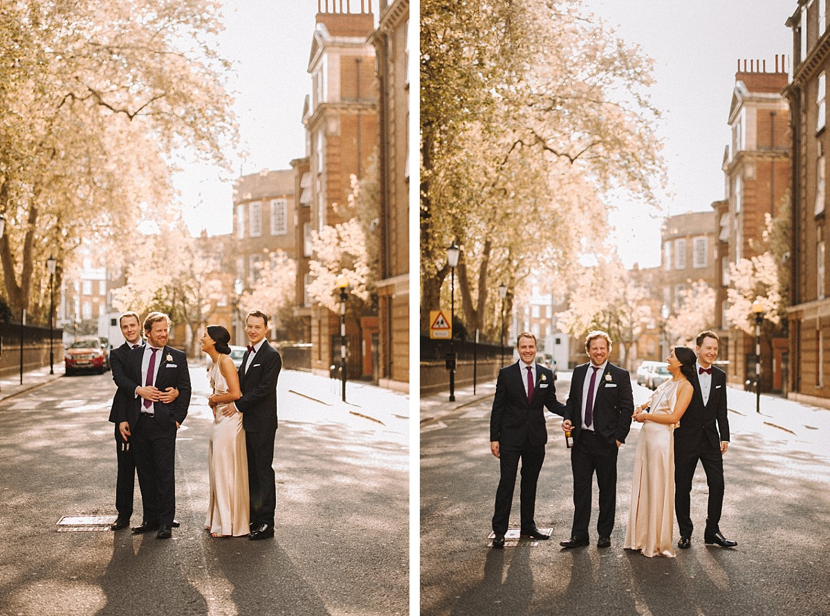 Bride and Groomsmen standing in street in Chelsea