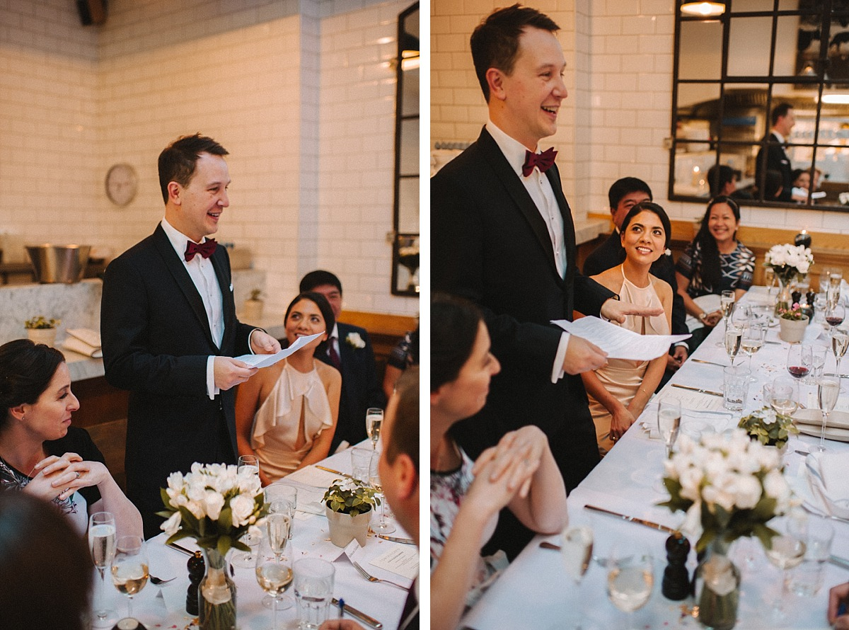 Photograph of Bride looking at Groom giving speech