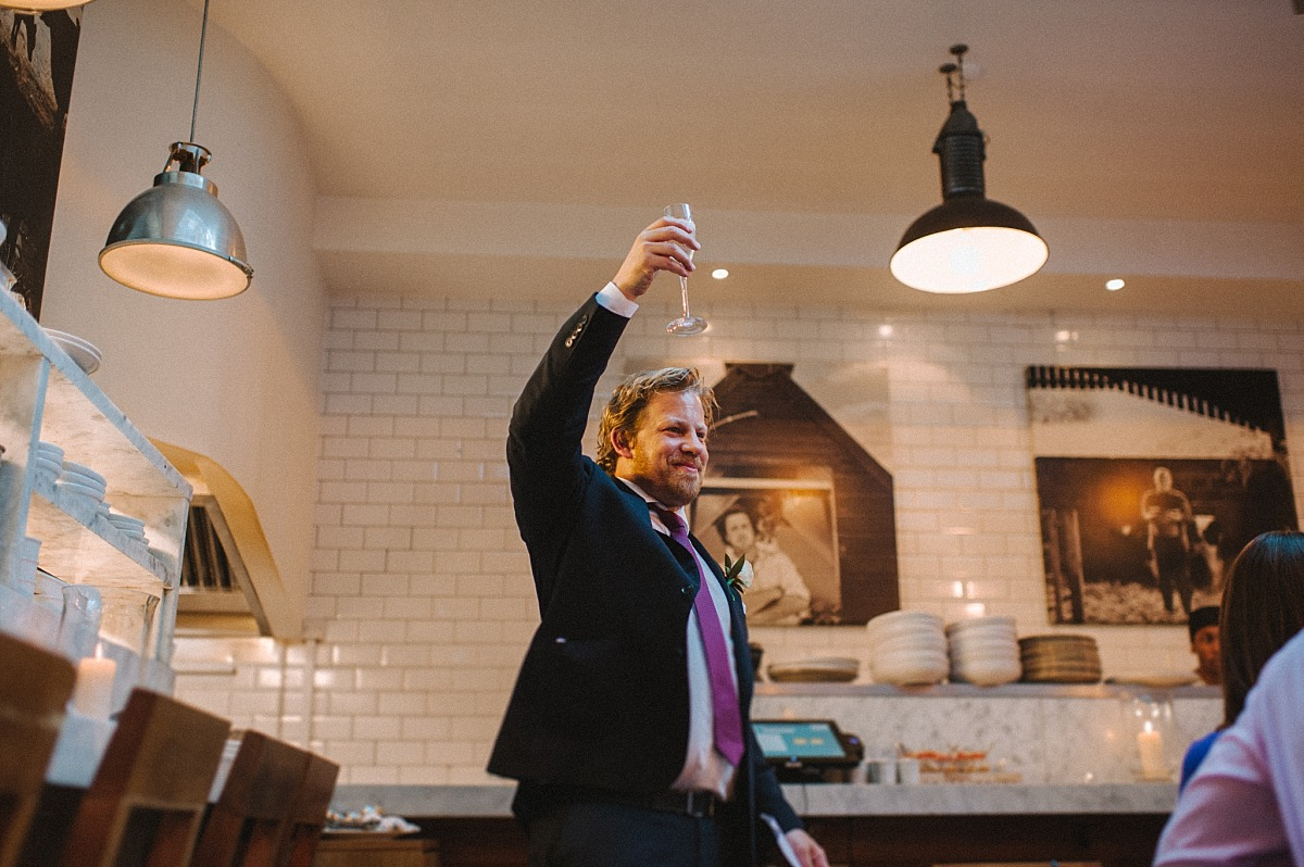 Bestman toasting Bride & GroombyChelsea Wedding Photographer Matt Lee