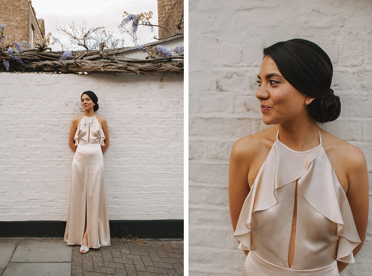 Stylish bride standing against wall on a Chelsea Street