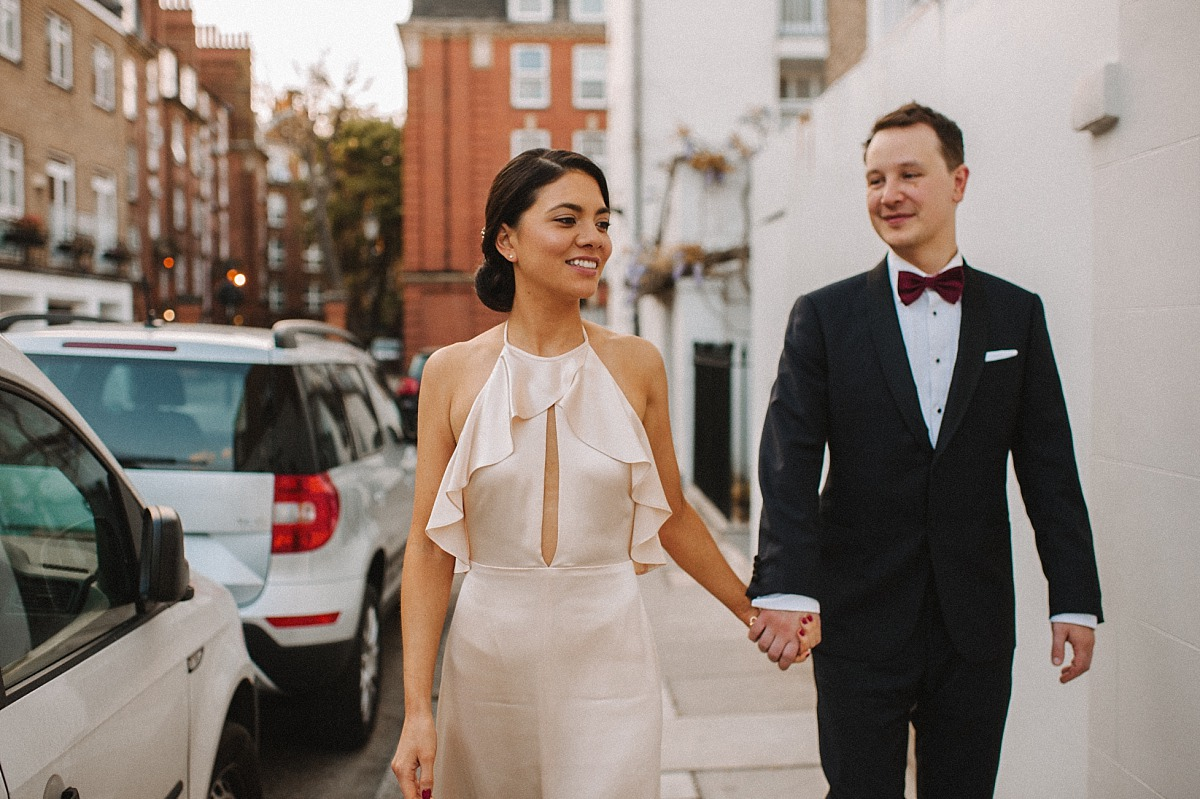 Good looking Bride holding hands with new Groom