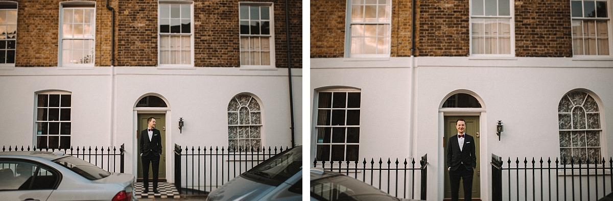 Groom standing in doorway in Chelsea street