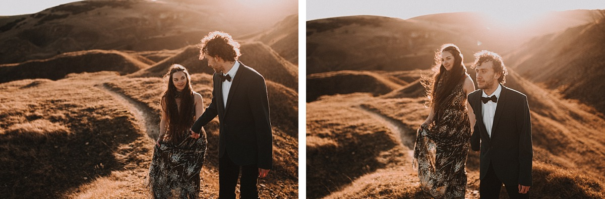 Man in suit holding hands with girl in dress by Cotswolds Wedding Photographer