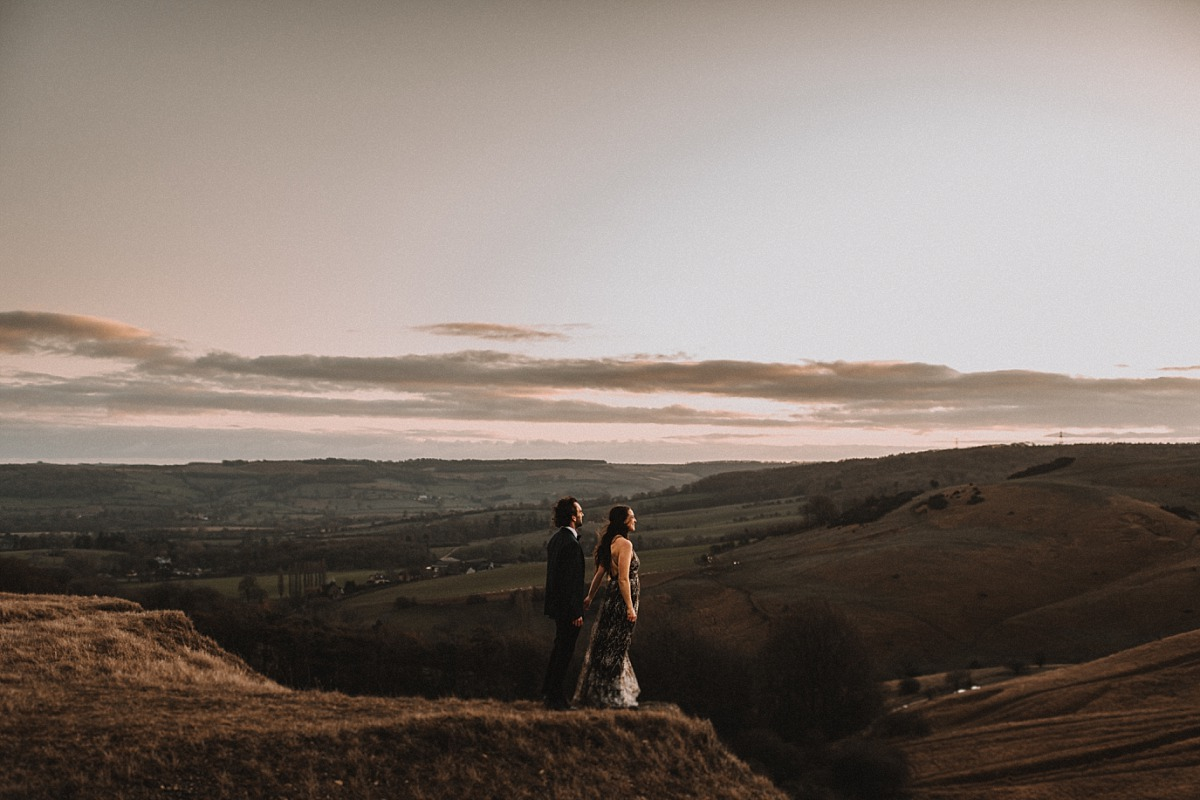 Couple looking into the sunset, by Cotswolds Wedding Photographer