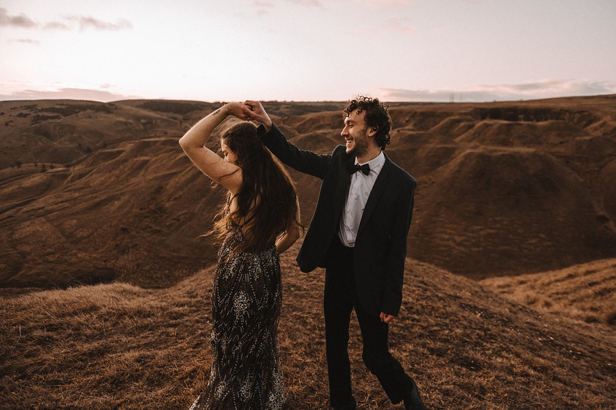 Boho couple dancing in the sunrise by Matt Lee Photography