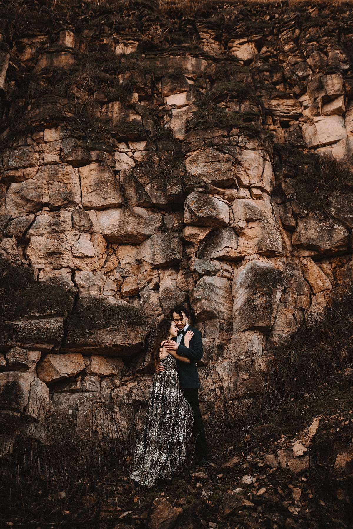 Couple in love infront of large cliff