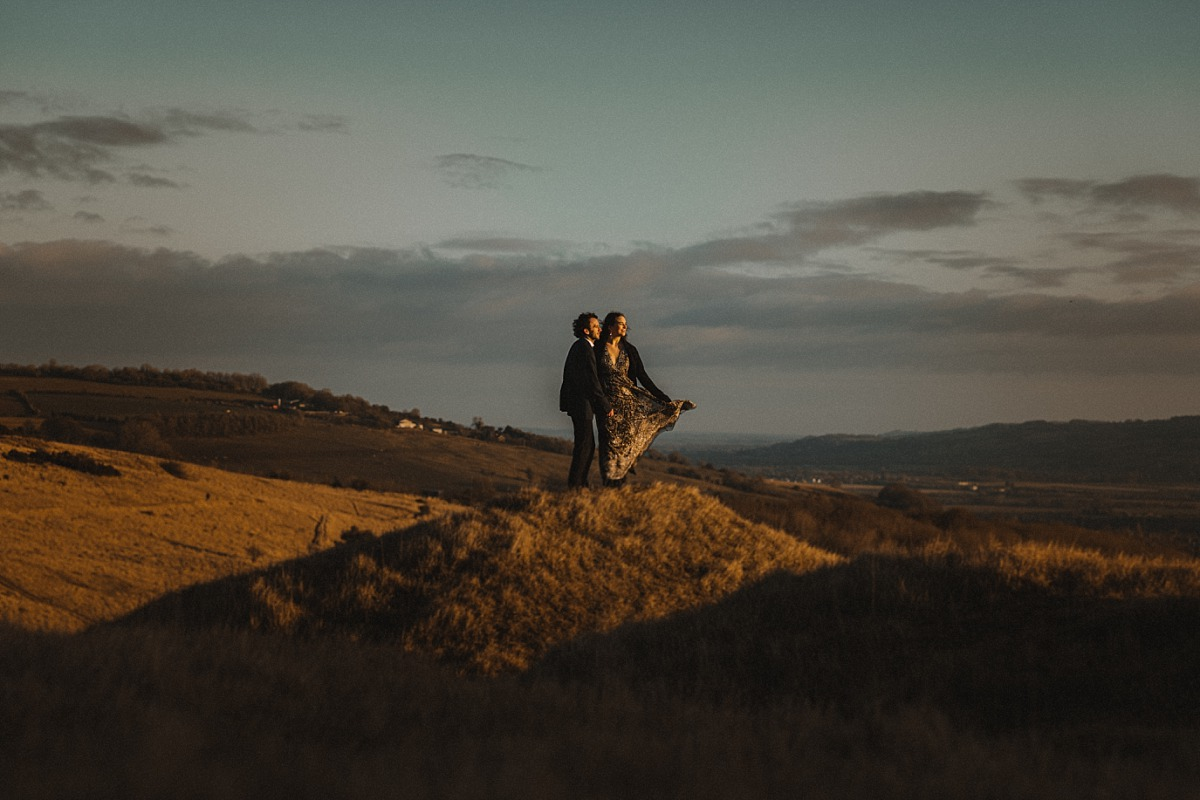 Photo of couple looking at the sunrise
