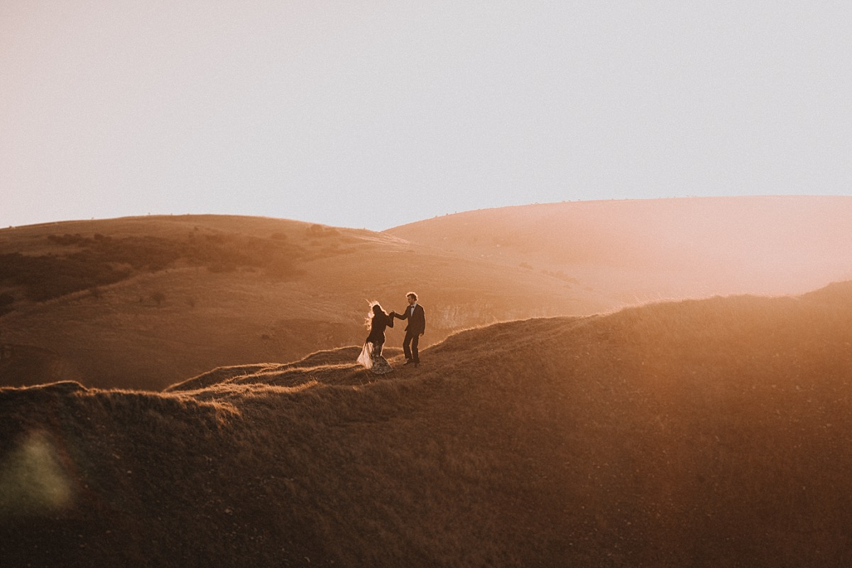 Amazing wedding photo on a hill at Sunrise