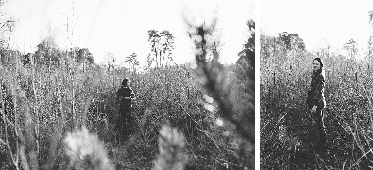 Black & White photo of stylish girl standing in forest