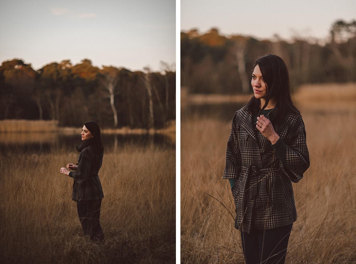 Good looking girl standing near lake
