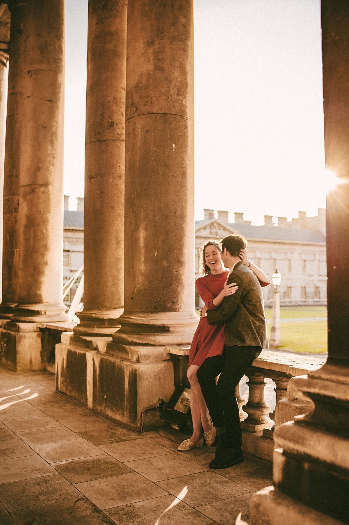 Couple having fun in London in the evening by Greenwich wedding photographer