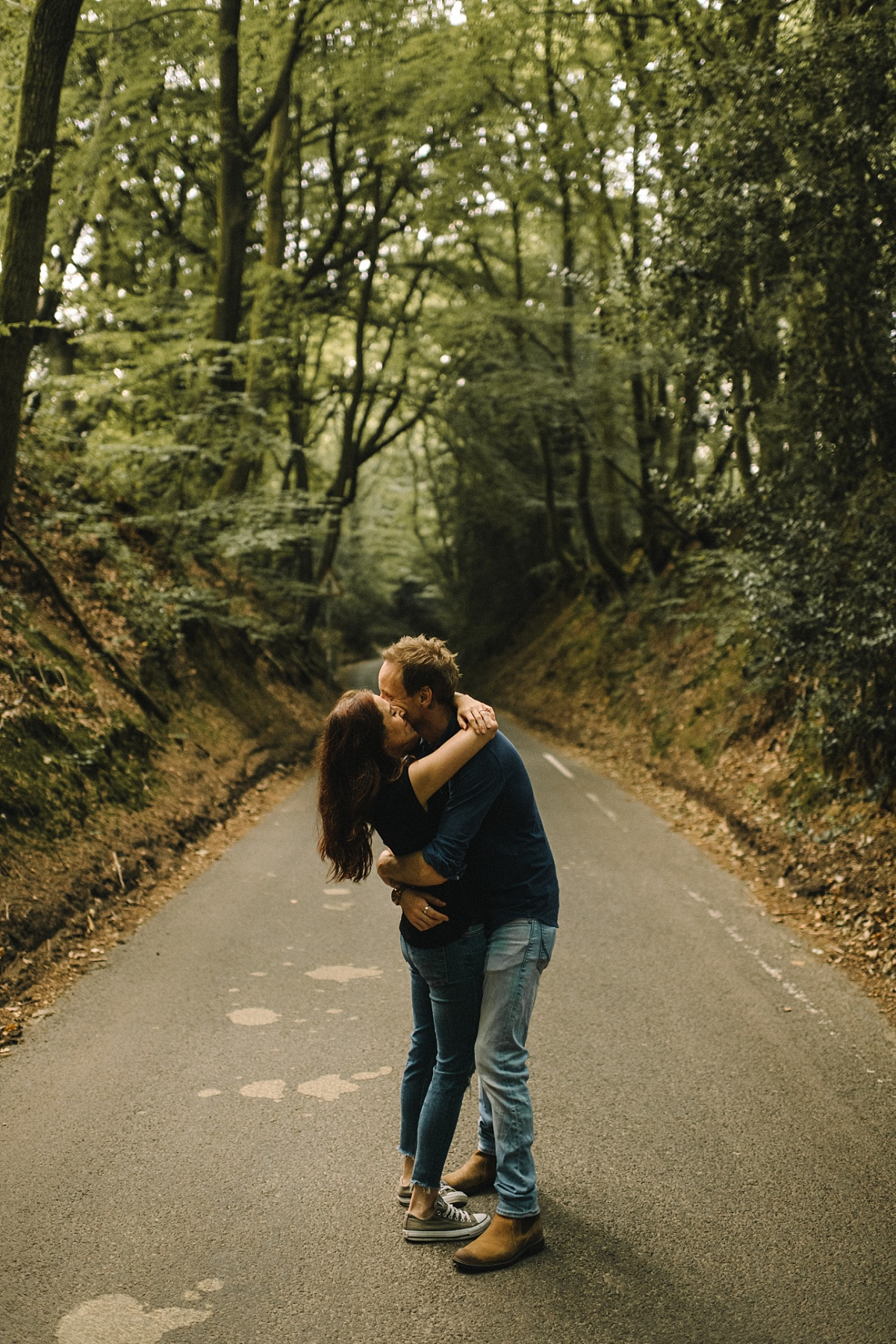 wedding couple kissing in road
