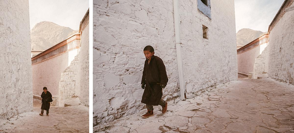 Young boy walking through city in Tibet