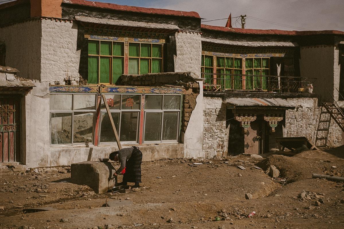 Tibeten lady outside her house