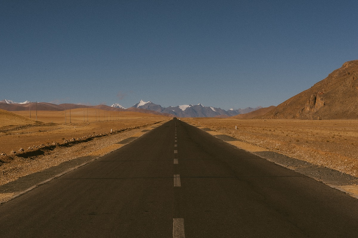 Endless road in the plains of Tibet